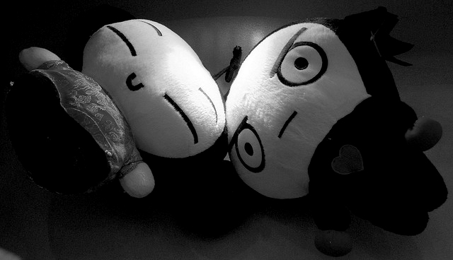 Photo of happy and sad dolls.